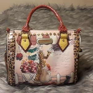 Nicole Lee speedy handbag.